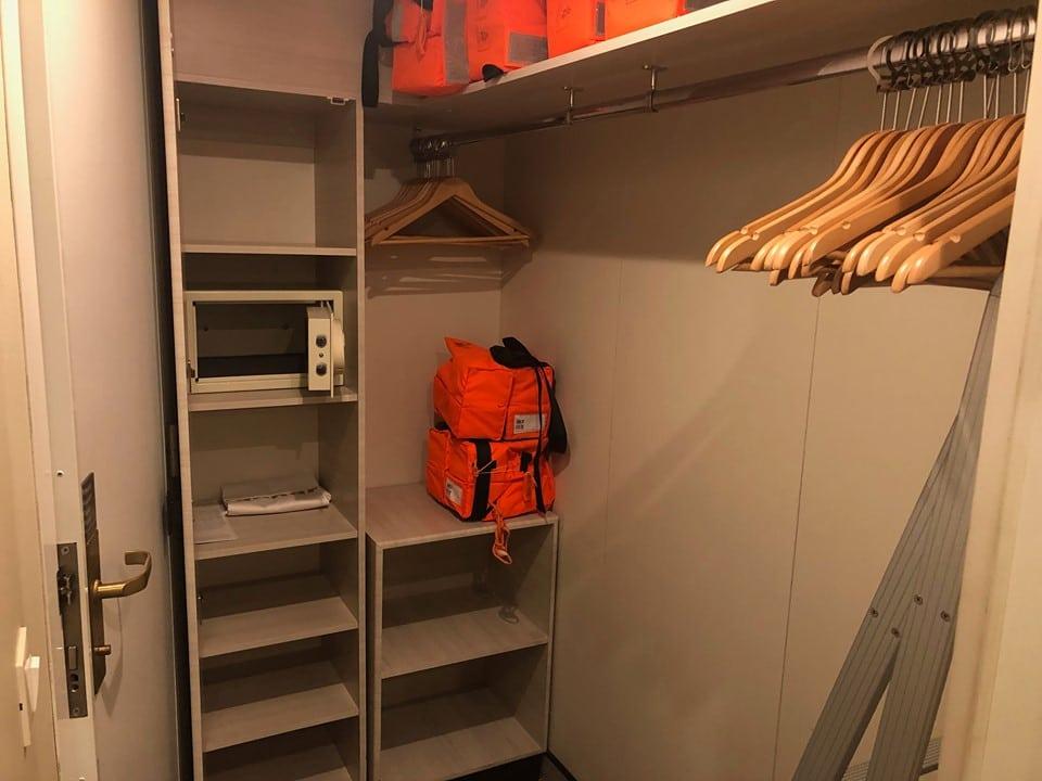 storage in wardrobe area in Britannia inside cabin