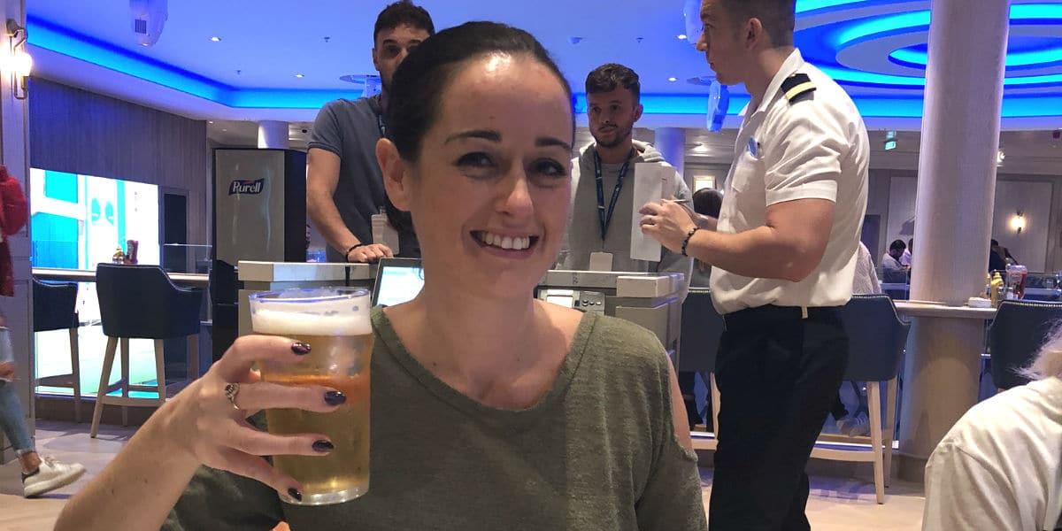 enjoying a beer on Norwegian Encore