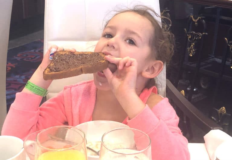 Leonie with chocolate spread in the mai9n dining room on Mariner of the Seas