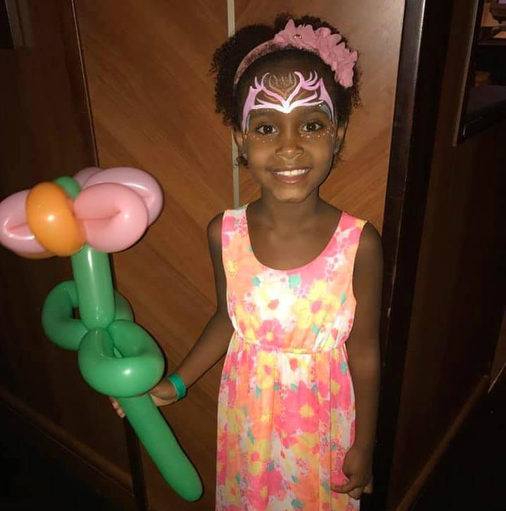 birthday girl with balloon on Oasis of the Seas