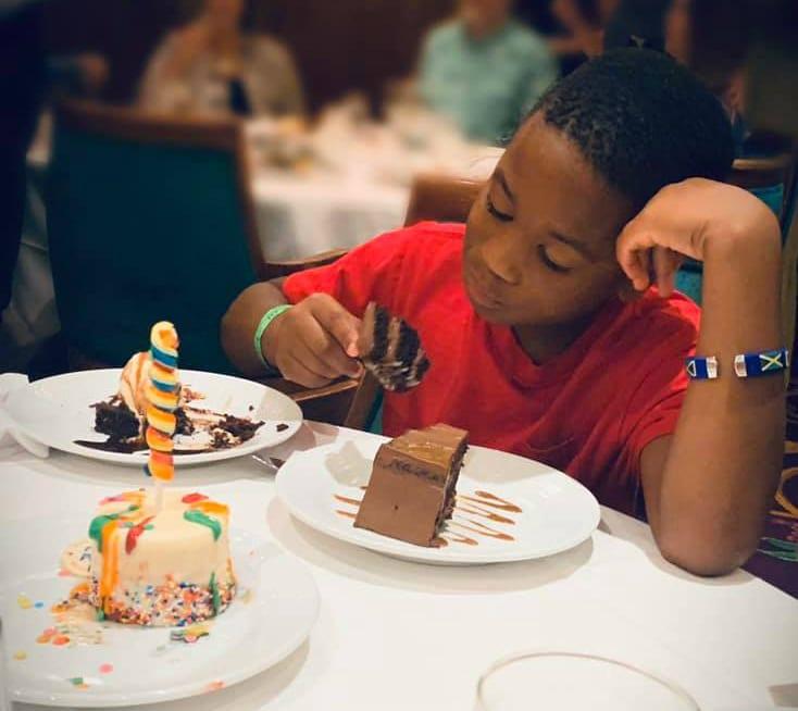 Boy with three desserts on cruise ship