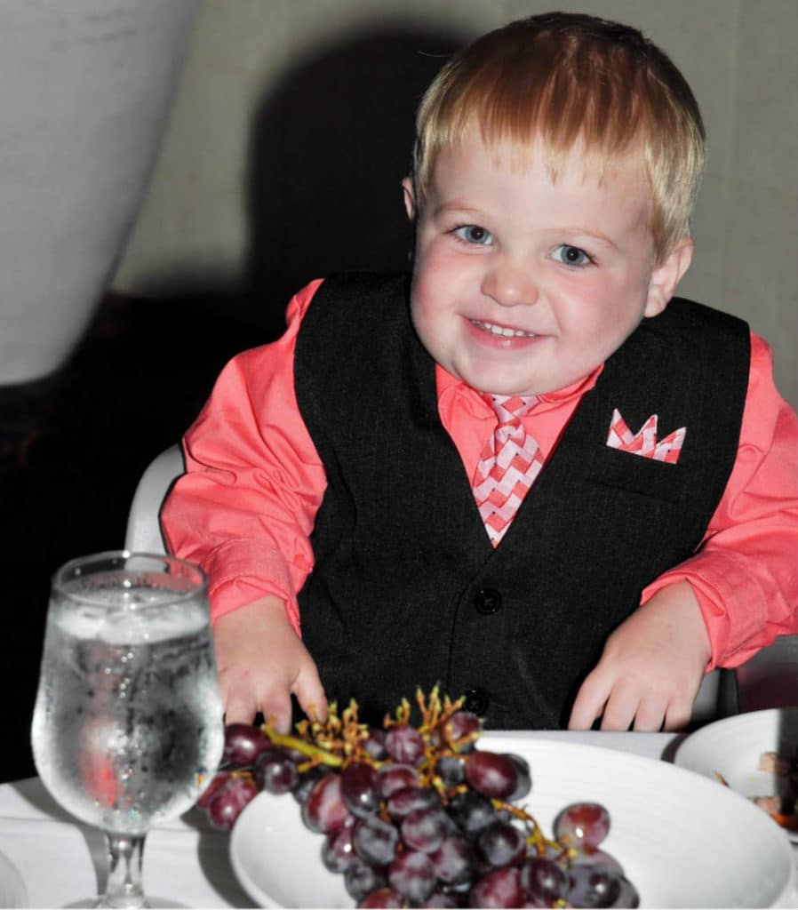 boy with grapes in main dining room on Royal Caribbean cruise