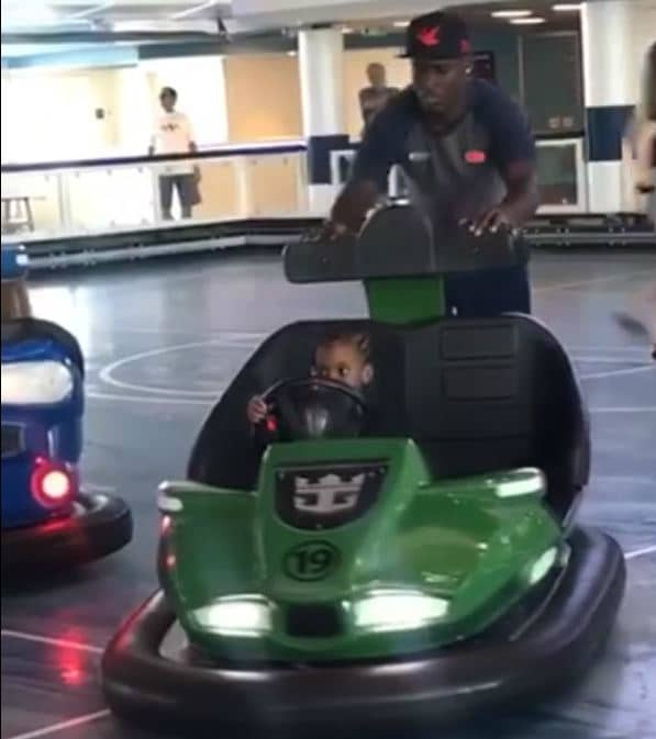 girl being pushed in bumper cars