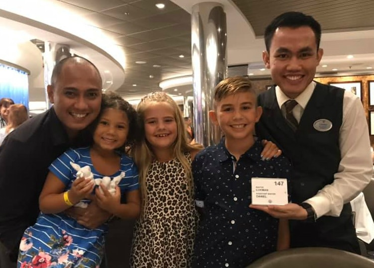 kids with waiters on Harmony of the Seas