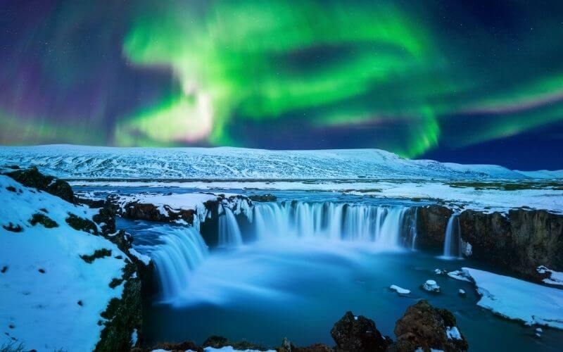 The Northern Lights over the Godafoss Waterfall