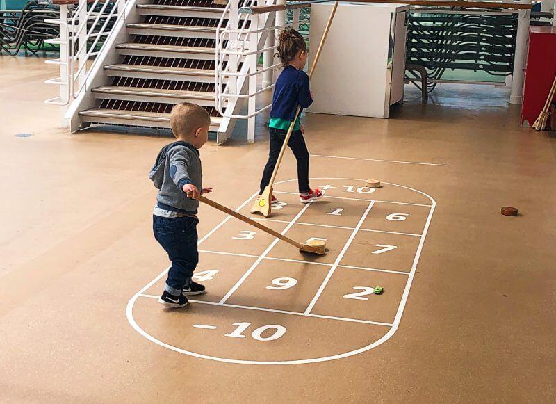 Kids playing shuffleboard on Britannia